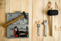 Different working and repair tools. On a wooden background with space for text stock photography
