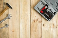 Different working and repair tools. On a wooden background with space for text royalty free stock photos