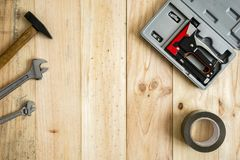Different working and repair tools. On a wooden background with space for text royalty free stock photography