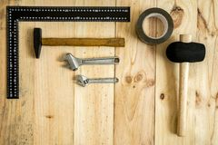 Different working and repair tools. On a wooden background with space for text royalty free stock photo