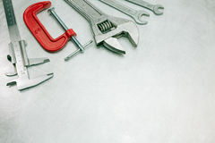 Different working tools on scratched metal background Royalty Free Stock Image
