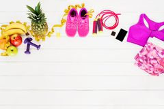 Different workout accessories on white floor Royalty Free Stock Images
