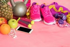 Different workout essentials on floor Stock Images