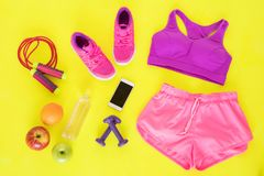 Different workout essentials on yellow floor Stock Photo
