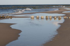 Different world 2, sunset. Polish beach, silence after storm, some sea water left Stock Photography