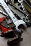 Different wrenches on a metal background Royalty Free Stock Image