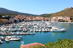 Different yachts in the harbour of Porto Ercole, Italy Stock Photo