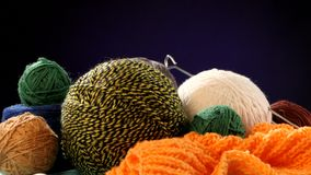 Different yarn balls with spokes on orange scarf stock video footage