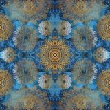 Golden mandalas on blue wall royalty free stock image