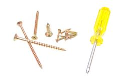 Different yellow screwdriver and golden screws on white Stock Photos