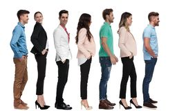 Different young  people standing in line royalty free stock images