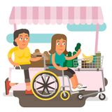Wheelchair shopping. Differently abled female shopping on wheelchair with friend Royalty Free Stock Photography
