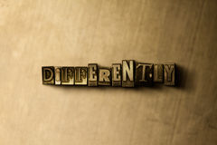DIFFERENTLY - close-up of grungy vintage typeset word on metal backdrop Stock Images