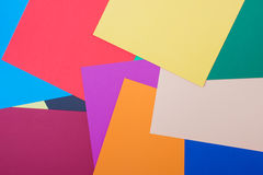 Differently colored papers. Background of differently colored papers Royalty Free Stock Photos