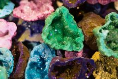 Differently coloured geodes cut open Stock Images
