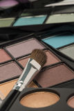 Differently shaped light eye shadow selection with a brush Stock Photo