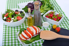 Differents  salads with bottle of oil ,salt and pepper Royalty Free Stock Photography