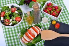 Differents  salads with bottle of oil ,salt and pepper Stock Photography