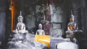Statues of Buddha in a temple in Angkor Wat. Differents statue of Buddha with differents positions in Angkor Wat, Cambodia Stock Image