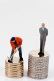 Differenza di stipendio fra gli operai ed i gestori Immagine Stock