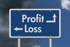 Differenza fra profitti e perdite fotografia stock