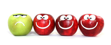 Differing from others. Apples-smilies symbolise themselves difference of one from the others Royalty Free Stock Photos