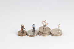 the differnet class of figure with coins Stock Photo