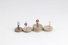 the differnet class of figure with coins Stock Photos