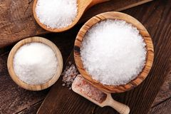 Differnt kind of sugar in wooden bowl and spoon royalty free stock images