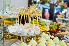 Differrent cup cakes at wedding reception table.  royalty free stock images