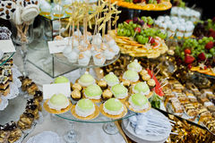 Differrent cup cakes at wedding reception table.  royalty free stock photography