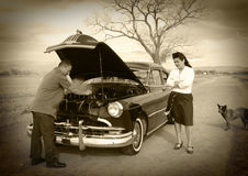 Difficoltà dell'automobile, difficoltà della moglie Immagini Stock