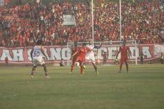 DIFFICOLTÀ INDONESIANE DI CALCIO Fotografia Stock