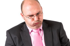 Difficult. Businessman pulling a face that signals trouble Stock Photo