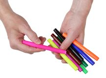 Difficult agonizing choice of a colored felt-tip pen from a heap Royalty Free Stock Photo