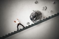 Difficult career. Concept of difficult career of a businessman with falling rocks Royalty Free Stock Photos