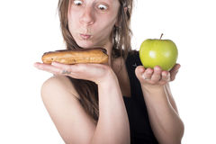 Difficult choice between cake and apple Royalty Free Stock Photography