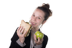 Difficult choice between cake and apple Stock Images