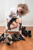 Difficult choice of shoes Stock Photo