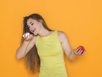 Difficult choice between sweets and healthy food stock image