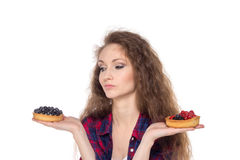 Difficult choice between two cakes Stock Photo