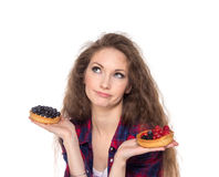 Difficult choice between two cakes Royalty Free Stock Photos