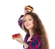 Difficult choice between two cakes Stock Photos
