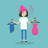 Difficult choice. Young teenage girl trying to decide what to wear Royalty Free Stock Images