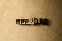 DIFFICULT - close-up of grungy vintage typeset word on metal backdrop. Royalty free stock illustration.  Can be used for online banner ads and direct mail Royalty Free Stock Image