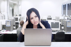Difficult computer project. Businesswoman having difficult computer project while working in her office Royalty Free Stock Images