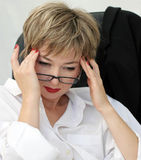 Difficult decision. Businesswoman in eyeglasses Stock Photos