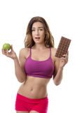 Difficult decision! Healthy lifestyle concept. Royalty Free Stock Image