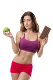 Difficult decision! Healthy lifestyle concept. Stock Photos