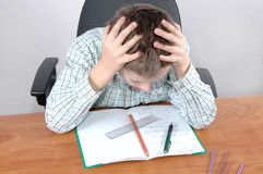 Difficult homework. Boy has a problem with his homework Stock Photos